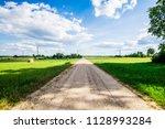 a view of a dirt road through... | Shutterstock . vector #1128993284