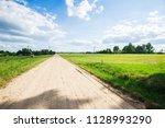 a view of a dirt road through... | Shutterstock . vector #1128993290
