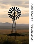 an old windmill on a farm in a... | Shutterstock . vector #1129014590