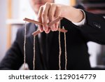 close up of a businessperson's... | Shutterstock . vector #1129014779