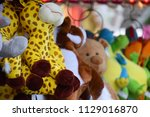 cuddly toys on a fairground   Shutterstock . vector #1129016870