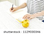 counting asian woman with... | Shutterstock . vector #1129030346