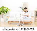 smiling pregnant japanese woman | Shutterstock . vector #1129030379