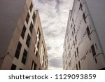modern apartment buildings... | Shutterstock . vector #1129093859