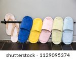 colorful slippers for using... | Shutterstock . vector #1129095374