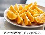 sliced oranges on plate | Shutterstock . vector #1129104320