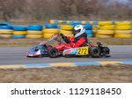 young go cart racer on circuit | Shutterstock . vector #1129118450