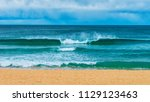 eden sea spray. this beach with ... | Shutterstock . vector #1129123463