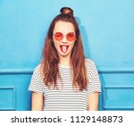 young stylish girl model in... | Shutterstock . vector #1129148873