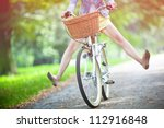 Woman Riding Bicycle With Her...