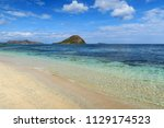 white sand and transparent... | Shutterstock . vector #1129174523