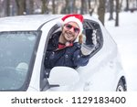 driver with santa hat and...   Shutterstock . vector #1129183400