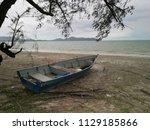 A Stranded Fibre Glass Boat...