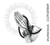 praying hand drawing with rays... | Shutterstock .eps vector #1129185869