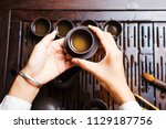woman serving chinese tea in a... | Shutterstock . vector #1129187756