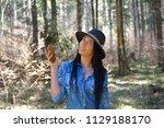 beautiful young woman enjoy by ... | Shutterstock . vector #1129188170