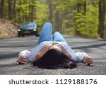 sexy woman sitting on the road | Shutterstock . vector #1129188176