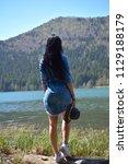 beautiful young woman enjoy by ... | Shutterstock . vector #1129188179