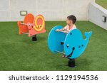 adorable little boy play in... | Shutterstock . vector #1129194536
