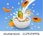 papaya with oatmeal flakes in... | Shutterstock .eps vector #1129194956