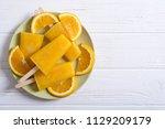 homemade orange popsicle .... | Shutterstock . vector #1129209179