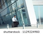 business man working on... | Shutterstock . vector #1129224983