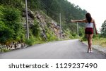 sexy girl stands on hitchhiking ... | Shutterstock . vector #1129237490