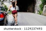 sexy brunette stands sideways... | Shutterstock . vector #1129237493