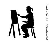 a painter is drawing silhouette ... | Shutterstock .eps vector #1129241993