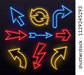 neon light arrows. colorful... | Shutterstock .eps vector #1129245293