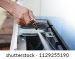 engineer or repairman fixing... | Shutterstock . vector #1129255190
