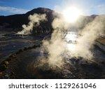 visiting el tatio  a geyser...   Shutterstock . vector #1129261046