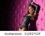 sexual girl in a corset on a... | Shutterstock . vector #112927129