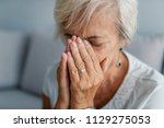 senior woman suffering from... | Shutterstock . vector #1129275053