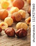 hazelnuts on wooden table | Shutterstock . vector #1129275860