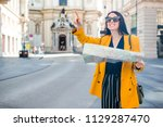 happy young woman with a city... | Shutterstock . vector #1129287470