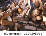 pile of firewood. preparation... | Shutterstock . vector #1129295036