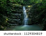 a small beautiful waterfall in... | Shutterstock . vector #1129304819