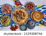 uzbek cuisine  food  pilaf ... | Shutterstock . vector #1129308746