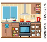 spacious and bright kitchen... | Shutterstock .eps vector #1129312676