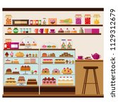 pastry shop  cafe with lots of... | Shutterstock .eps vector #1129312679