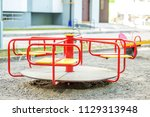 red carousel on the playground... | Shutterstock . vector #1129313948