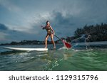 woman stand up paddle boarding... | Shutterstock . vector #1129315796