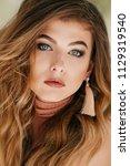 portrait of beautiful young... | Shutterstock . vector #1129319540