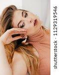 portrait of beautiful young... | Shutterstock . vector #1129319546