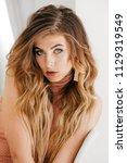 portrait of beautiful young... | Shutterstock . vector #1129319549
