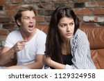 young millennial upset couple... | Shutterstock . vector #1129324958