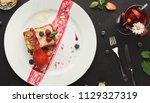 exquisite restaurant dessert.... | Shutterstock . vector #1129327319