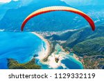 paragliding in the sky.... | Shutterstock . vector #1129332119
