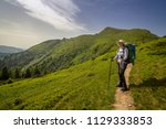 a girl hikers in the carpathian ... | Shutterstock . vector #1129333853